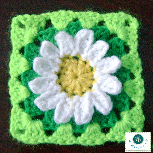 The 3D crochet wild daisy granny square pattern is crocheted ...